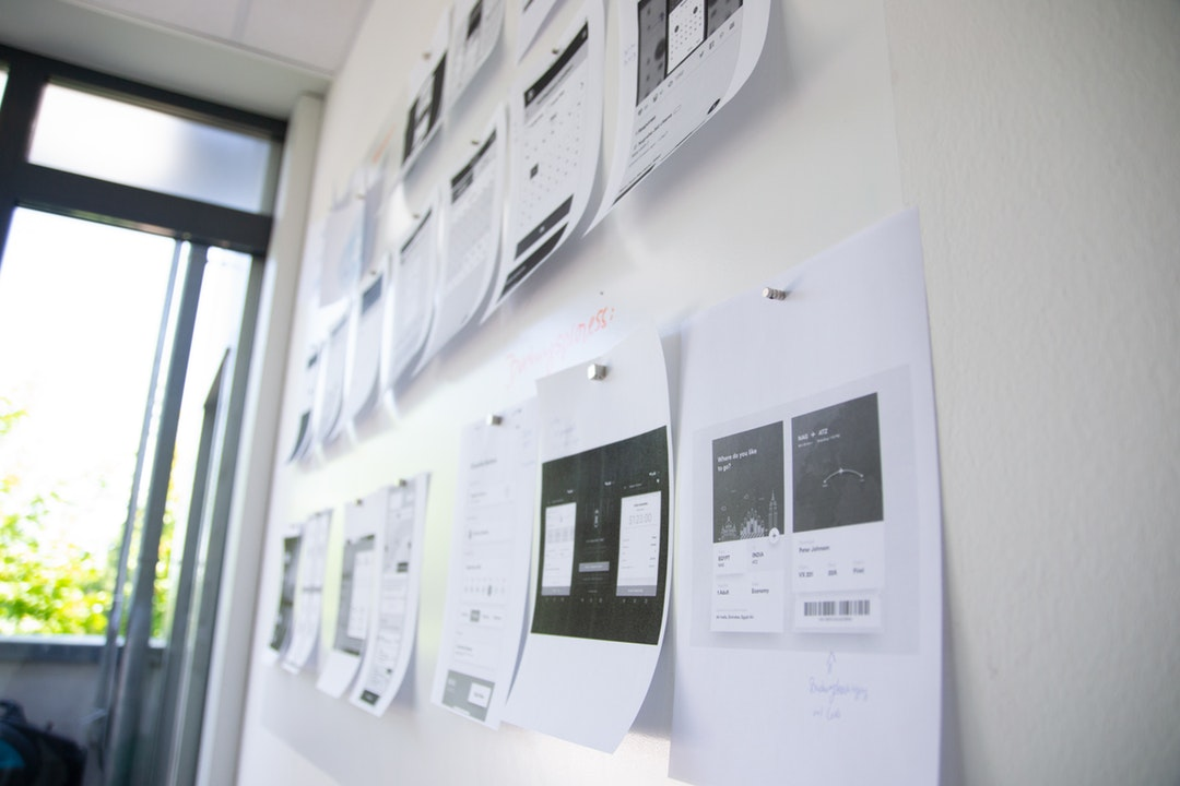 printouts of app wireframes
