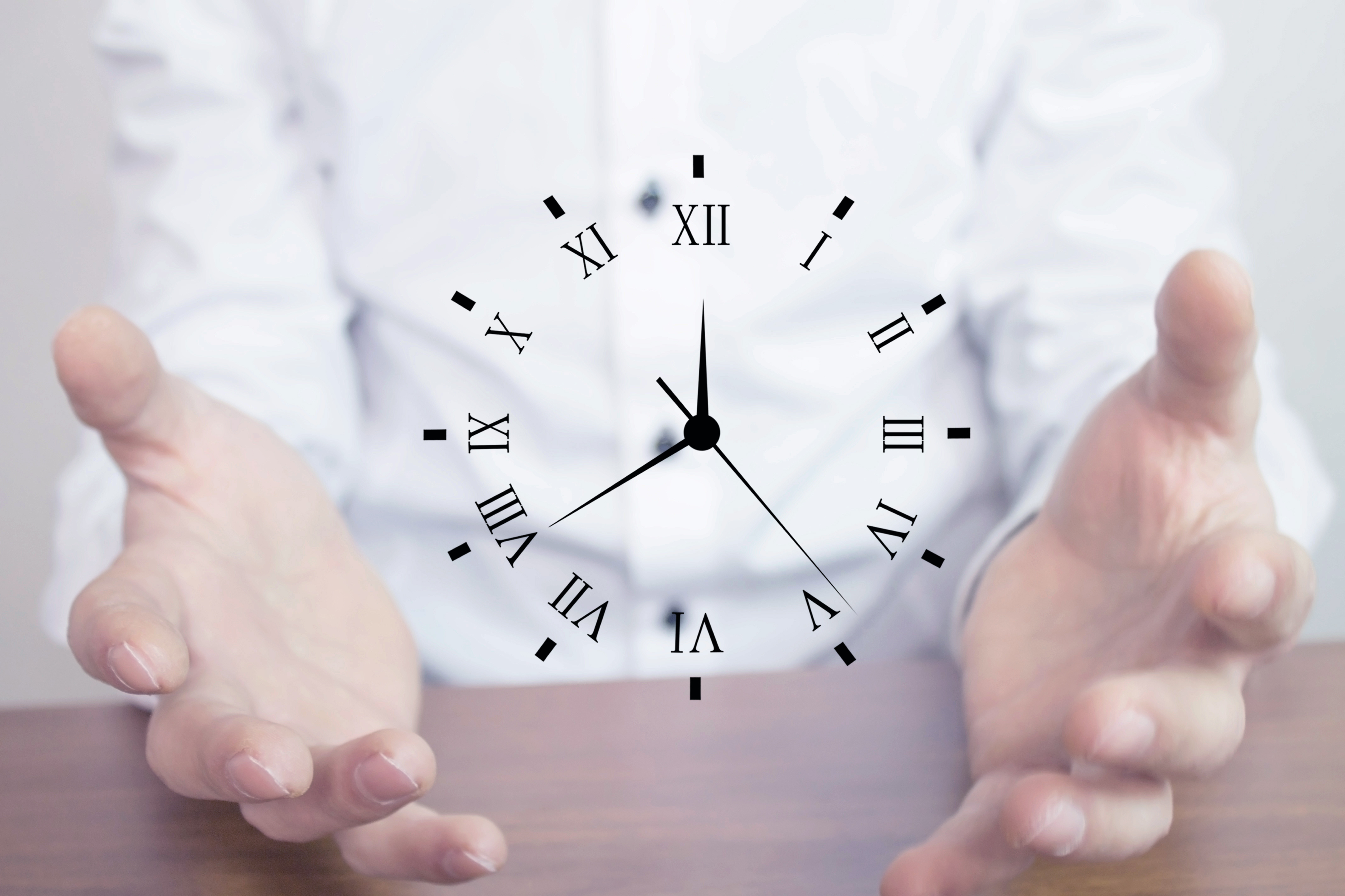 hands holding clock