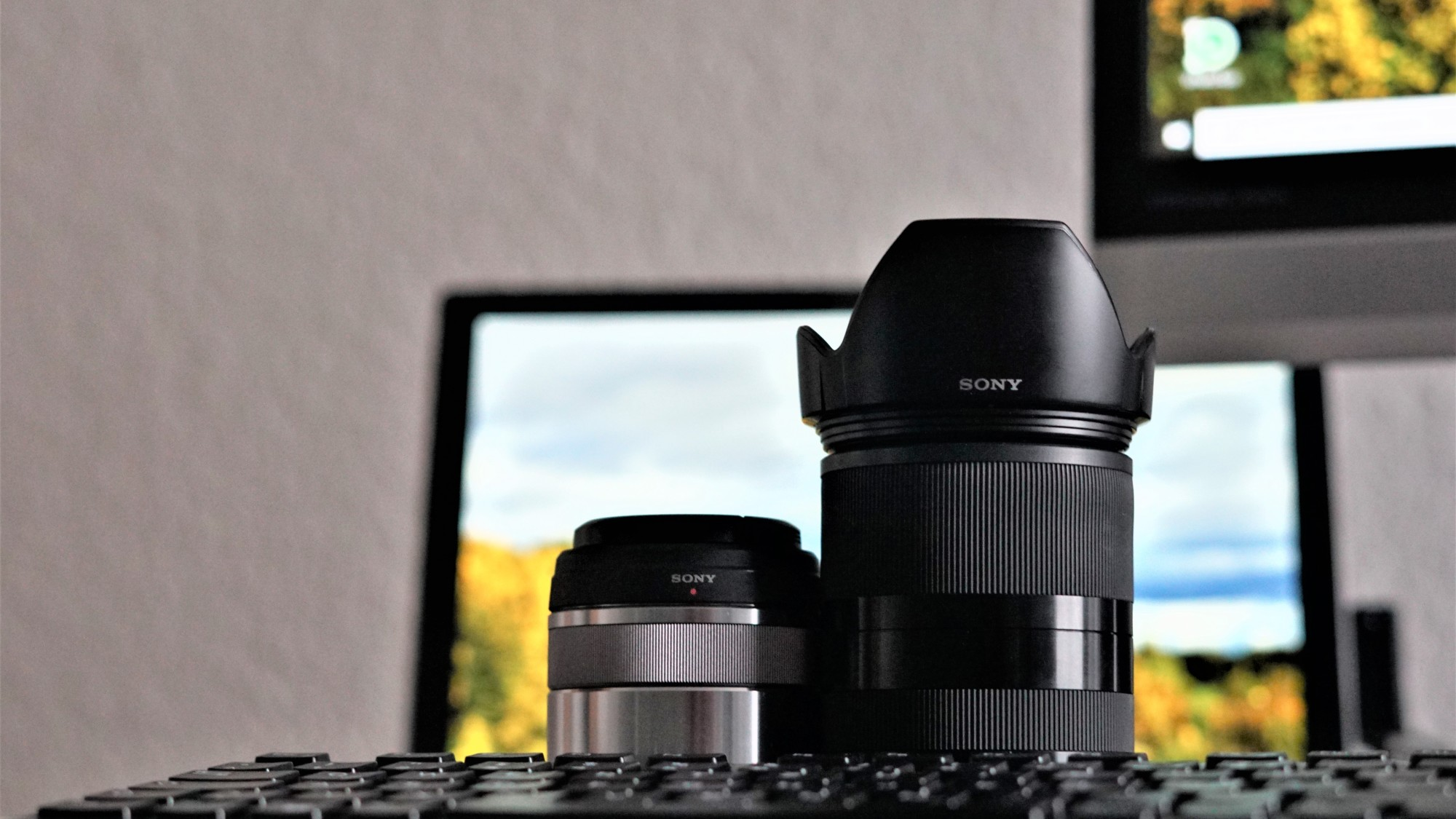 DSLR Lens in front of a Laptop
